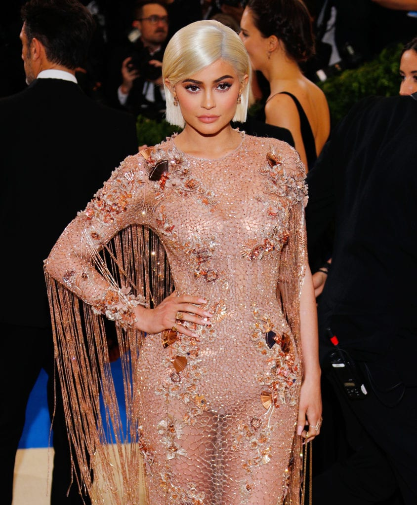 Kylie Jenner attends the 2017 Met Gala in a short blonde bob and Versace dress
