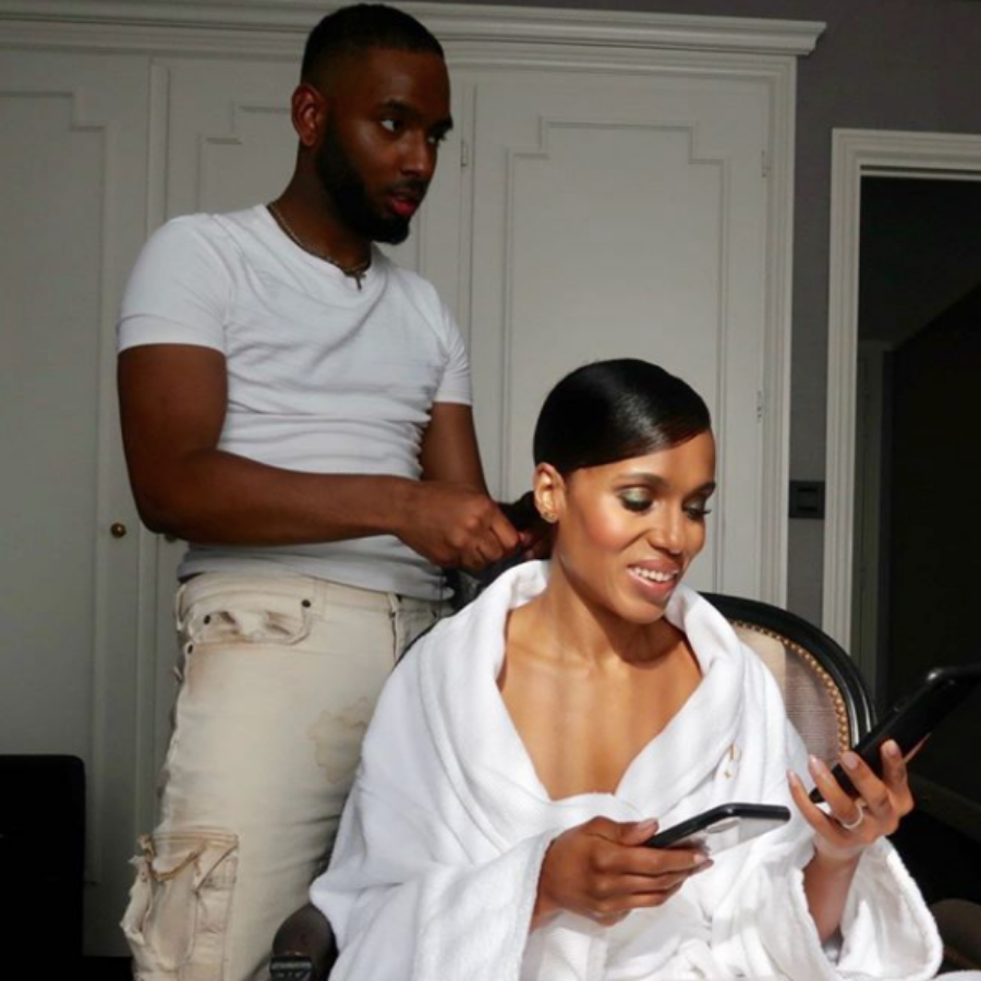 Rio Sreedharan, a Black hairstylist to follow on Instagram, doing Kerry Washington's hair for an event