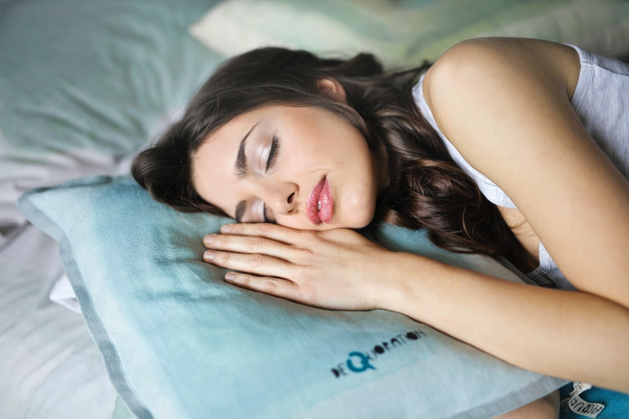Girl sleeping on a blue pillow