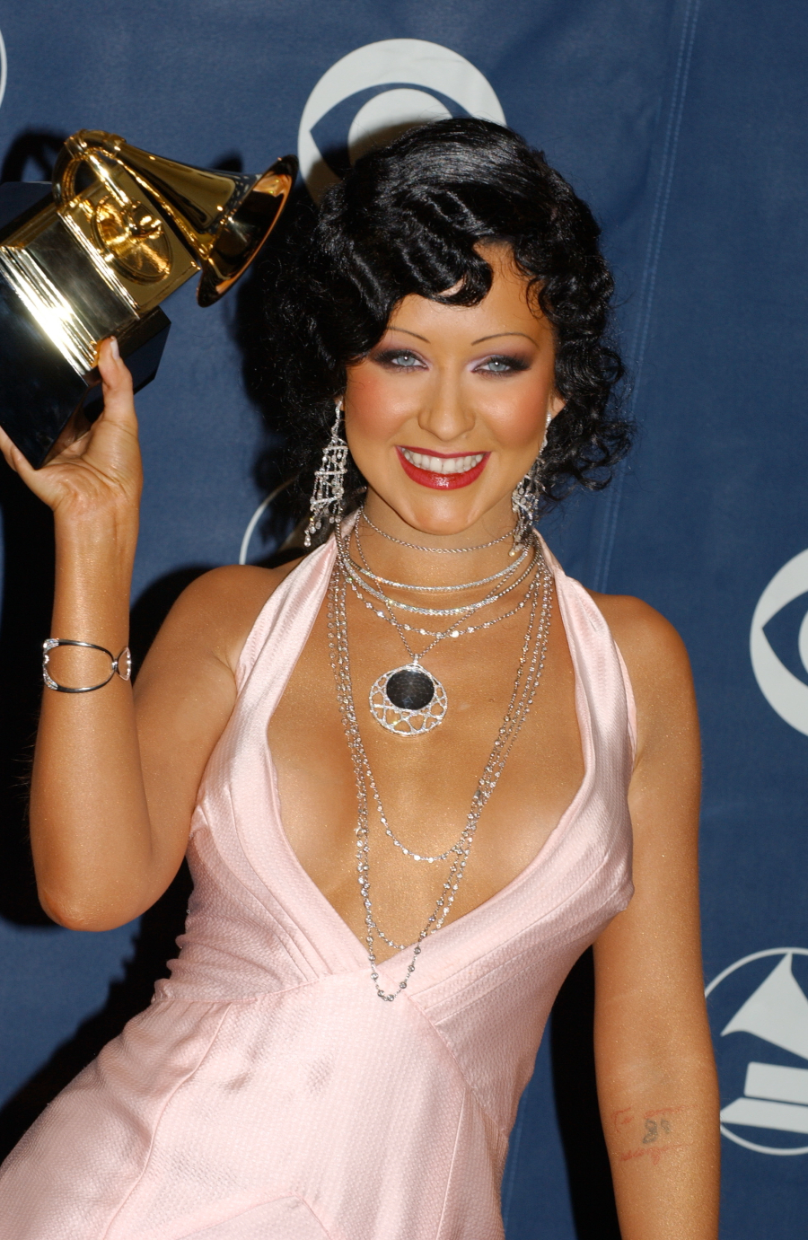 Christina Aguilera with her award for Best Female Pop Vocal Performance in the press room at the 46th annual Grammy Awards. (Photo by Frank Trapper/Corbis via Getty Images)