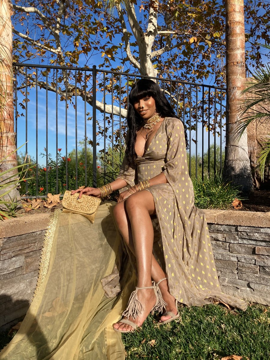 Lana Patel in a gorgeous nude colored dress